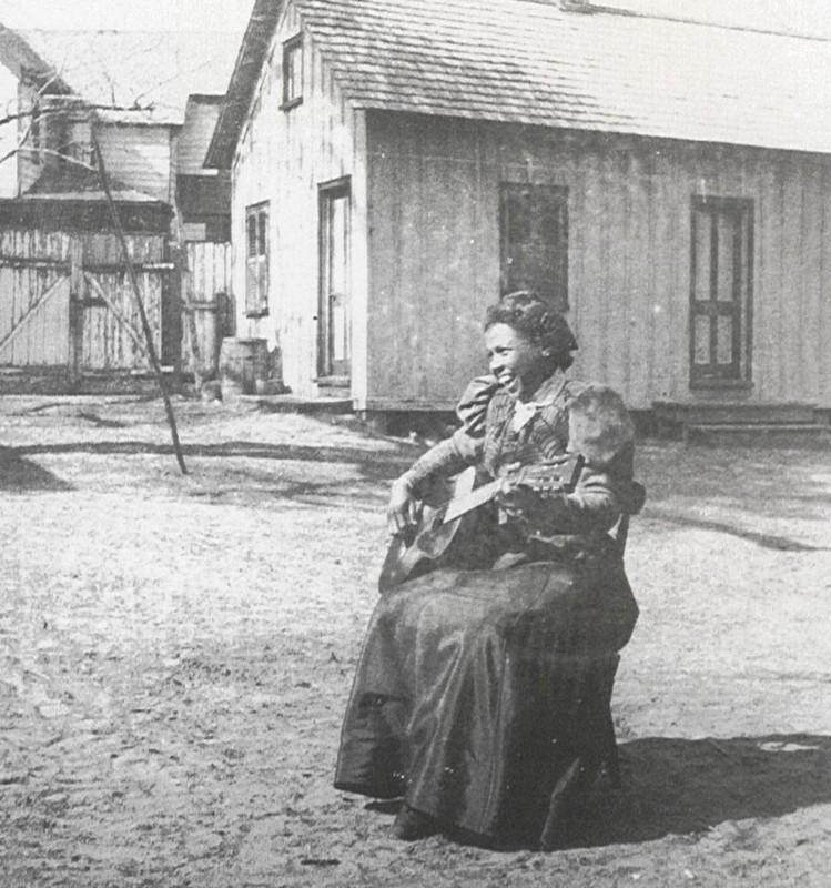 Teacher with guitar, circa 1900